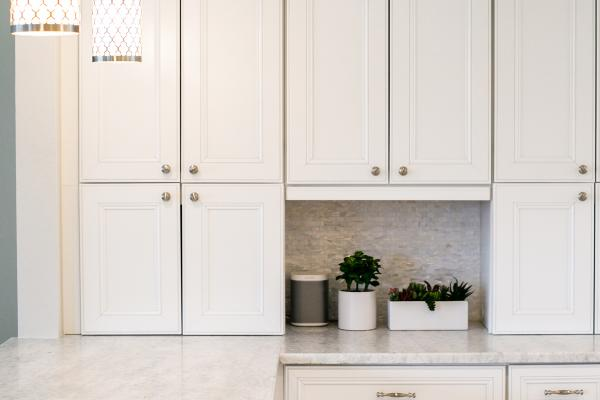 detail of stacked cabinetry set on countertop