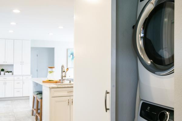 laundry room closet integrated into kitchen
