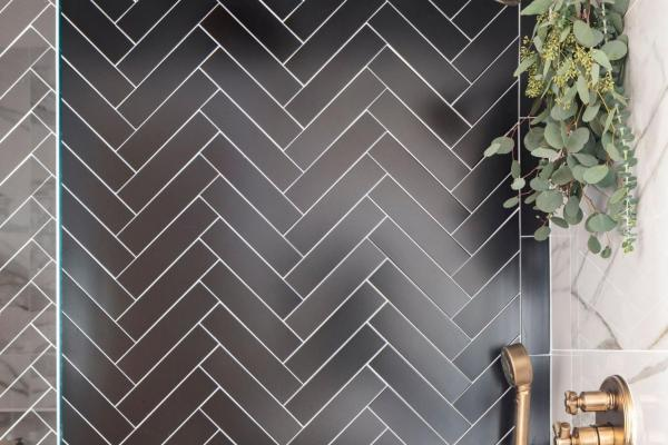 Black chevron pattern shower wall tile