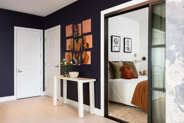 Entryway with purple wall and white console table