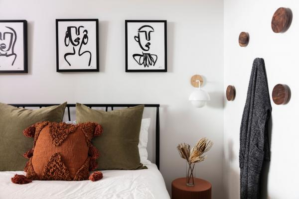 Bright guest room with white walls and art