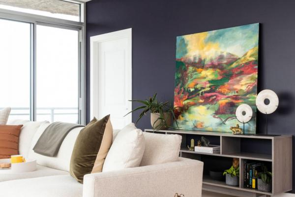 Modern living room with purple wall and artwork