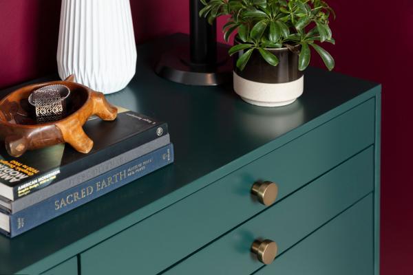 Emerald green dresser with brass hardware